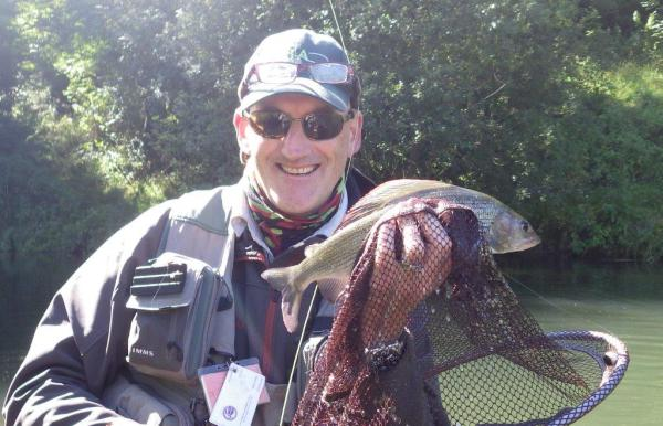 Andy Grey with a grayling caught fly fishing
